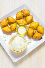 Pineapple fruit fritters with icecream