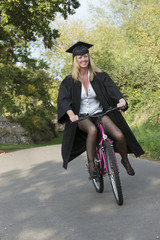Mature university student riding bicycle