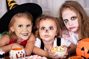 brother and two sisters on  Halloween party