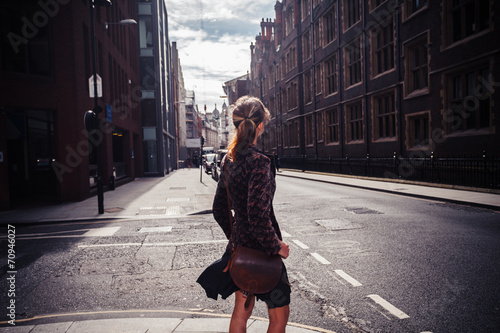 Young woman walking in the street - 70946027