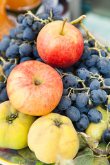 Bunch of quince with apples and grapes