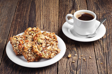 Sweet cookies with nuts and coffee