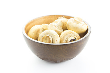 Champignon mushroom in wooden bolw