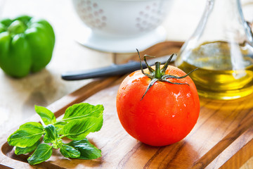 Tomato,Basil and Bell pepper on chopping board
