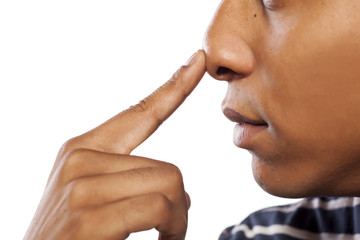 dark-skinned young man pressed his nose with his finger