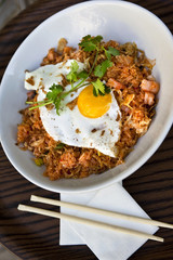 Fried egg, rice and grilled shrimp on a plate