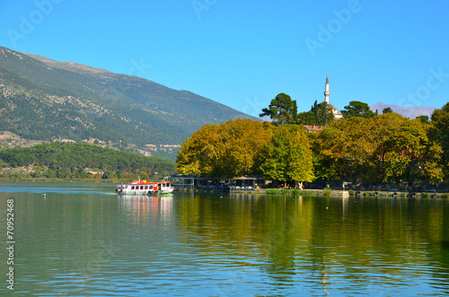 Leinwanddruck Bild Ioannina lake Pamvotis and boat to the island