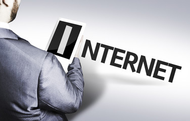 Business man with the text Internet in a concept image