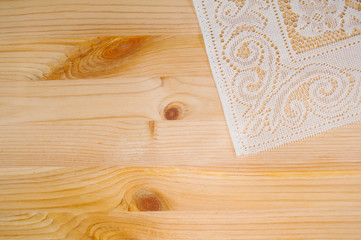 delicate white cloth on a wooden board