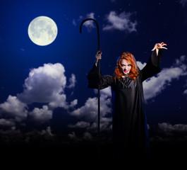 Witch girl on night sky background