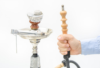 Hookah with coal and hose in a man's hand