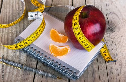 Foto op Canvas Vruchten Measuring tape wrapped around a apple weight loss photo