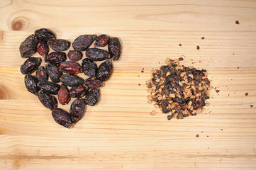 Dried wild rose on a wooden board