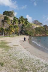 Beach at fortress walls. Fort-de-France, Martinique