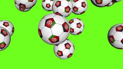 Afghanistan soccer balls falling on green background