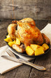 chicken baked with potatoes on a cast iron pan