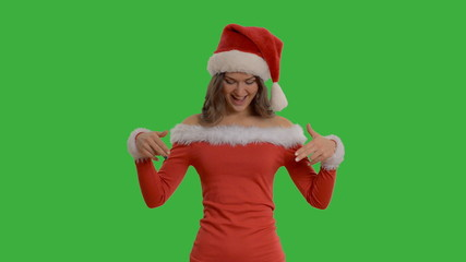 Young beautiful girl shows copy space in santa claus hat