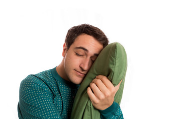 portrait of a sleepyhead man in pajamas with its beloved pillow