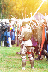 Knight in armor and a helmet with a long sword
