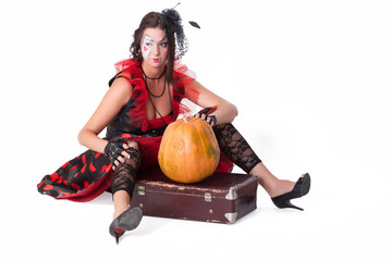 Pretty woman with suitcase and pumpkin