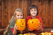 Kids showing their jack-o-lanterns