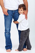 Child holding his father leg - safety and security concept