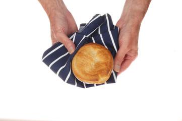 Hands holding pie