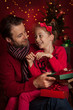 Christmas - smiling father and daughter enjoying gifts