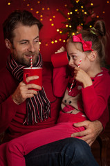 Christmas - father and daughter drink cocoa and having fun