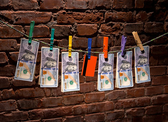 Dollar bills and credit card hanging on a rope