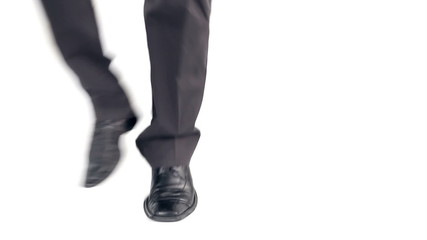 Feet of a happy businessman, close-up on white Background