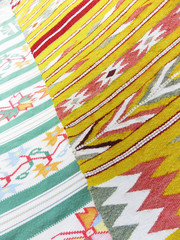 Colourful rug background divided into two sections