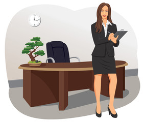 A business woman stands with a clipboard at the office