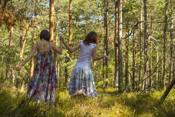 two women walking in the forest