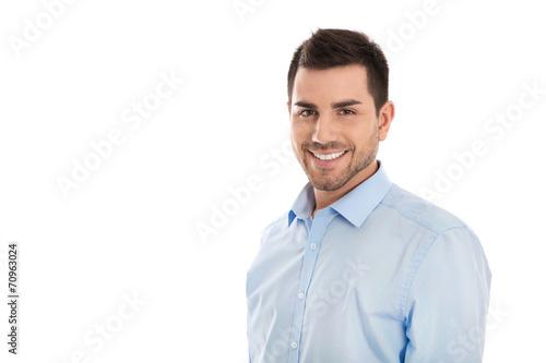 Leinwanddruck Bild Erfolgreicher junger lachender Geschäftsmann isoliert in Blau