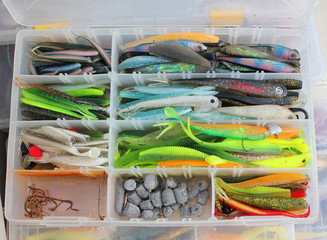 fisherman's tackle box with lures and gear for fishing