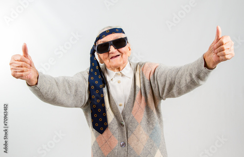 Poster bohemian grandma with a tie on her forehead