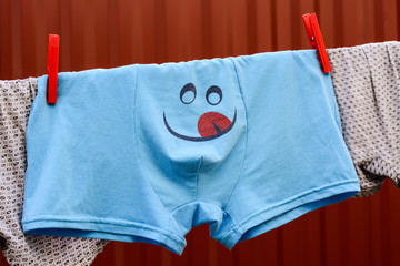 Briefs with smiley sticking out tongue