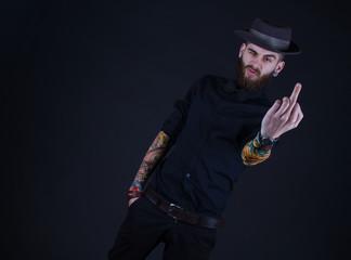 handsome hipster guy showing his middle finger