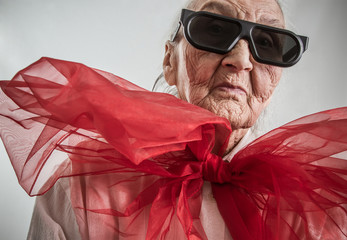 very old lady with a red bow