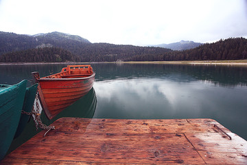 wooden boat on a mooring mountain lake
