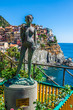 Ancient sculpture and view of Manarola.  La Spezia, Liguria, nor