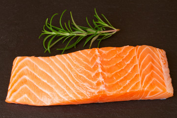 salmon steak with twig of rosemary