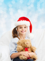 smiling little girl with teddy bear