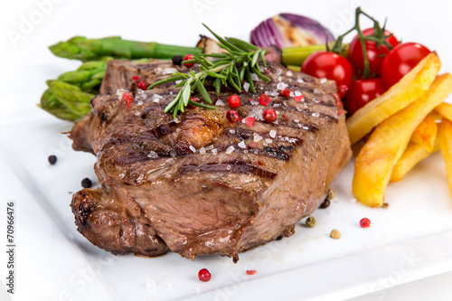 canvas print picture Beef steak on white background