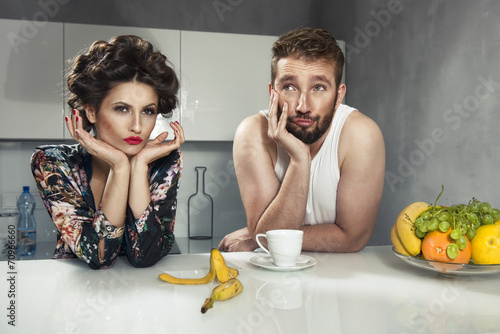 Funny couple after breakfast. Strange faces. - 70966660