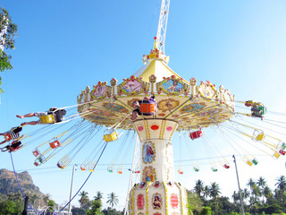 Chain swing ride in amusement park.