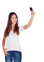 Attractive casual girl taking a photo with her mobile