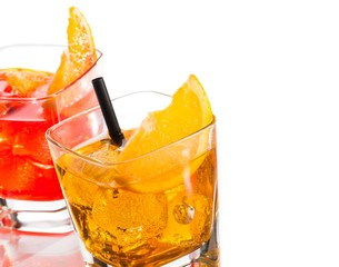 detail of two cocktail with orange slice on top isolated
