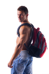 Shirtless muscular young man with rucksack